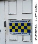 Small photo of Romsey, Hampshire, England - March 31, 2018: Police, SBD, secured by design, sign on commercial premises door, initiative supporting the principles of designing out crime through prevention
