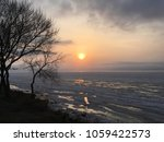 bare trees  sunset at the sea.... | Shutterstock . vector #1059422573