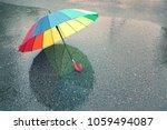 Colorful Umbrella In The Rain....