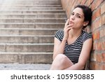 Beautiful young woman smoking - stock photo