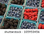 Baskets of berries at the farmers market - stock photo
