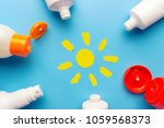sunscreen on blue background.... | Shutterstock . vector #1059568373