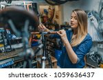 woman bicycle mechanic is... | Shutterstock . vector #1059636437