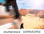 tourist white suv moves to meet ... | Shutterstock . vector #1059651953