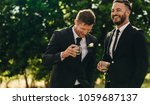groom and best man drinking and ... | Shutterstock . vector #1059687137