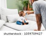 cute baby boy drinking water...   Shutterstock . vector #1059709427