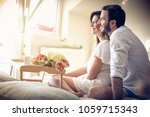 happy couple in bed. space for... | Shutterstock . vector #1059715343