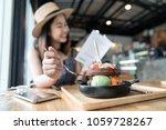 happy asian woman's traveller... | Shutterstock . vector #1059728267