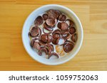a chocolate cereal in bowl is...   Shutterstock . vector #1059752063