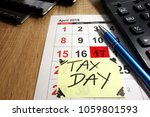 april 17th 2018   tax day in... | Shutterstock . vector #1059801593