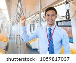 businessman catch handrail on... | Shutterstock . vector #1059817037