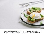 avocado sandwich with poached...   Shutterstock . vector #1059868037