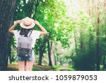 woman in the forest.enjoying... | Shutterstock . vector #1059879053