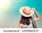 woman sitting on the beach   ... | Shutterstock . vector #1059882527