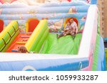 mom and child are riding a... | Shutterstock . vector #1059933287