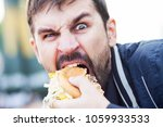 bearded man with an appetite... | Shutterstock . vector #1059933533