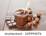 creamy praline surrounded by nuts and chocolate - stock photo