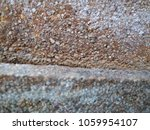 Small photo of The surface roughness of the stone walls and rough scrub.