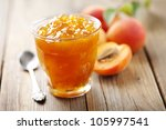 glass with homemade apricot jam - stock photo