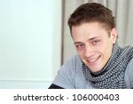 nice caucasian male sitting at...   Shutterstock . vector #106000403