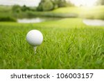 Golf Ball On A Tee Against The...