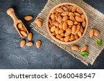 top view of almonds on dark... | Shutterstock . vector #1060048547