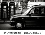 Taxi And Phone Booths On A...