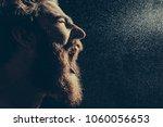 naked bearded man angrily... | Shutterstock . vector #1060056653