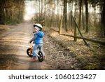happy toddler child boy riding... | Shutterstock . vector #1060123427