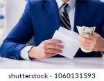 businessman receiving his...   Shutterstock . vector #1060131593