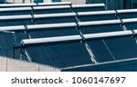 solar water heater on roof | Shutterstock . vector #1060147697