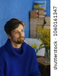 The Artist In A Blue Sweater I...