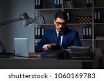 businessman working late at... | Shutterstock . vector #1060169783