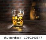 whiskey glass or glass of... | Shutterstock . vector #1060243847