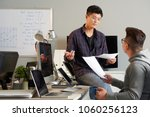 group of young asian colleagues ... | Shutterstock . vector #1060256123