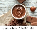 bowl with tasty melted...   Shutterstock . vector #1060324583