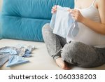 pregnant woman preparing baby...   Shutterstock . vector #1060338203