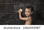 small boy washes the tile in... | Shutterstock . vector #1060343987