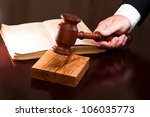 a hand holding a gavel and a... | Shutterstock . vector #106035773