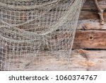fishing old network on wooden... | Shutterstock . vector #1060374767