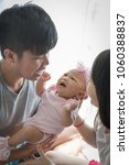 mom and dad soothe baby crying... | Shutterstock . vector #1060388837