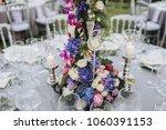 flower arrangement stands on... | Shutterstock . vector #1060391153