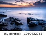 sunrise at a moody kingsbarns... | Shutterstock . vector #1060432763