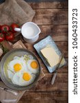 fried eggs in a frying pan with ... | Shutterstock . vector #1060433723