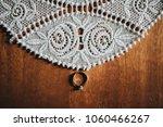wedding ring of the bride lies... | Shutterstock . vector #1060466267