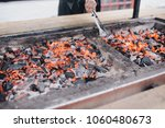 in the barbecue grill the coals ... | Shutterstock . vector #1060480673