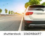 the car runs high on the road | Shutterstock . vector #1060486697