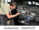 Insurance agent examining a car. - stock photo