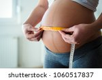 pregnant woman measuring... | Shutterstock . vector #1060517837