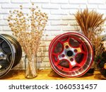 dry grass vase and alloy wheels | Shutterstock . vector #1060531457